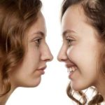 57193748 - portrait of a young woman, before and after rhinoplasty